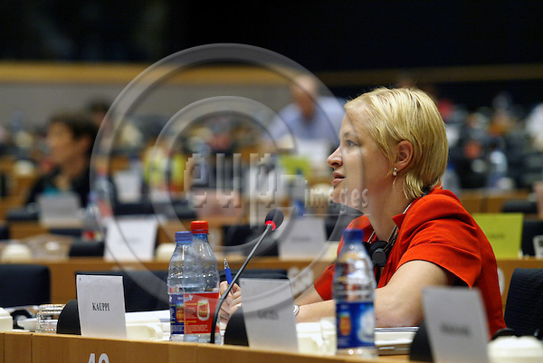 BRUSSELS -BELGIUM - 12 JULY 2006 -- Finnish MEP Piia-Noora KAUPPI sitting the meeting room at the EP during a committee meeting.  PHOTO: ERIK LUNTANG / EUP-IMAGES