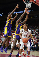 NWA Democrat-Gazette/ANDY SHUPE<br /> Arkansas forward Daniel Gafford (10) attempts a shot in the lane as he is pressured by LSU forwards Emmitt Williams (24) and Darius Days Friday, Jan. 11, 2019, during the first half of play in Bud Walton Arena in Fayetteville. Visit nwadg.com/photos to see more photographs from the game.