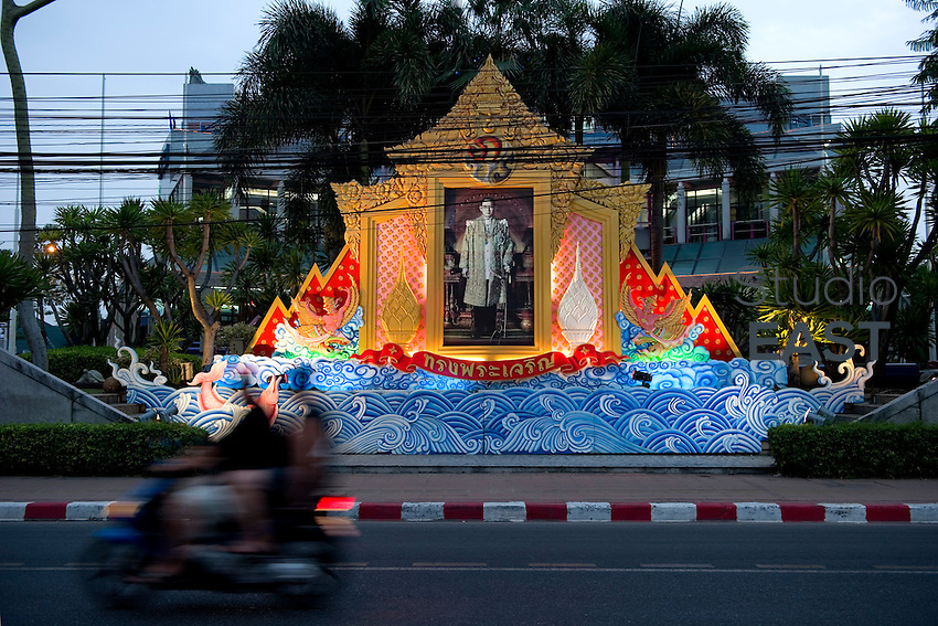 A motorcycle drives past a monument to the King of Thailand, in Pattaya, Thailand, on November 12. 2010. Photo by Lucas Schifres/Pictobank