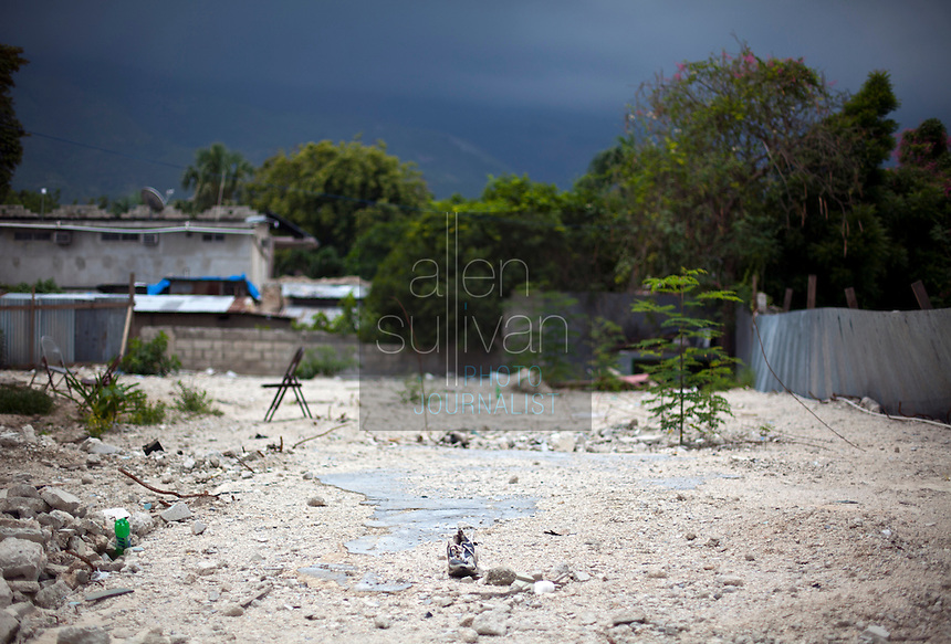 Little remains of a three-story building at the Episcopal University in Port-au-Prince, Haiti, next to the city's fire station. The building collapsed during the January 12 earthquake, killing over 40 people and injuring over one hundred. Many were saved by the firefighters from next door. The fire station itself has been deemed uninhabitable and marked for demolition, though no one can say when that may be. There are no plans yet for relocation. A few dozen under-equipped firefighters are tasked with providing fire service to a damaged city of over two million people.