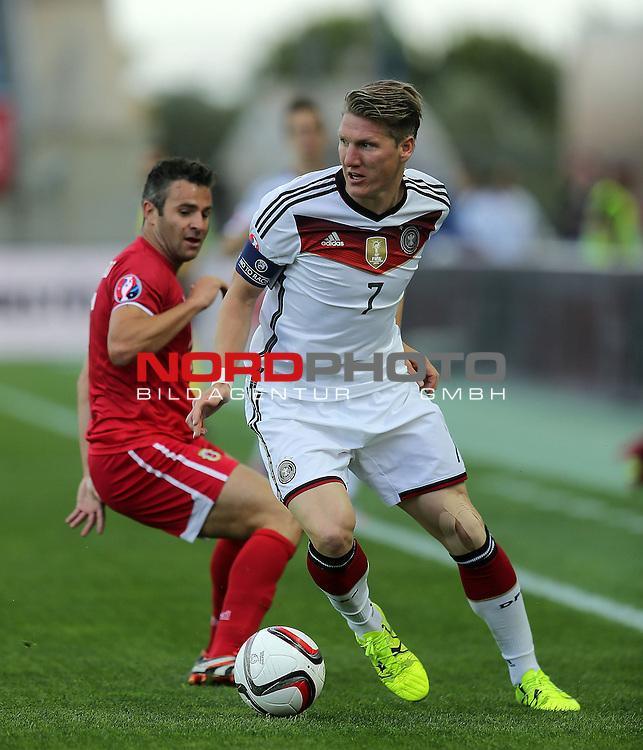 EM 2015 Qualifikationsspiel, Gibraltar vs. Deutschland<br /> Bastian Schweinsteiger (Deutschland), Lee Casciaro (Gibraltar)<br /> <br /> <br /> Foto &copy; nordphoto /  Bratic
