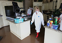 NWA Democrat-Gazette/DAVID GOTTSCHALK Kim Brown, the daughter of Don and Pat Faubus, walks Tuesday, June 4, 2019, through the kitchen of her parents home on Riverview Drive in Fort Smith. Tuesday was the first opportunity the family had to see the home following the flooding by the Arkansas River.
