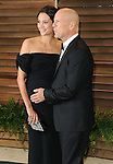 "Bruce Willis and wife Emma Heming arriving to the ""Vanity Fair Oscar Party 2014"" held in West Hollywood, Ca. on March 2, 2014."