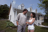 Ile D'Orleans, Quebec City Area, Canada, June 8, 1984. A couple in front of their house.