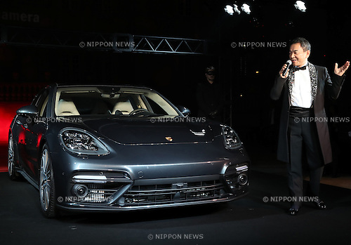 December 20, 2016, Tokyo, Japan - Porsche Japan president Toshiyuki Shimegi displays the new Panamera of German sports car maker Porsche in Tokyo on Tuesday, December 20, 2016. Porsche's four-door sedan Panamera has a 550-horse power 4.0-litter turbo charged engine to drive all wheels.  (Photo by Yoshio Tsunoda/AFLO) LWX -ytd-