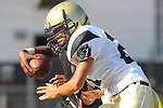 Beverly Hills, CA 09/23/11 - Takuma Takahashi (Peninsula #21) in action during the Peninsula-Beverly Hills frosh football game at Beverly Hills High School.