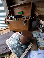 BNPS.co.uk (01202 558833)<br /> Pic: PhilYeomans/BNPS<br /> <br /> Field telephone and War magazine add to the authenticity in an officers dug out.<br /> <br /> Students of Garth Hill College in Bracknell get used to life in the trenches.<br /> <br /> Class War - A school has turned part of its playground into a replica First World War trench system that makes an fascinating and poignant living history classroom.<br /> <br /> The scaled down trenches allows pupils to get an authentic, hands-on lesson on what life and conditions were like for the unfortunate soldiers who served on the Western Front. <br /> <br /> As well as being given educational talks, students also get muddy taking part in re-enactment demonstrations in the trenches. <br /> <br /> The attention to detail includes replica rifles, bayonets, shell casings and even models of the ever present rats.<br /> <br /> The outdoor classroom is the first of its kind in the country and schools from miles around are booking up visits for their students to experience the real feel of the award winning movie 1917.