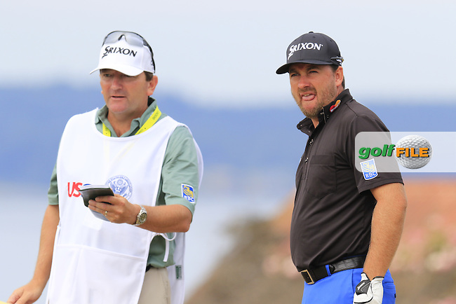 Graeme McDOWELL (NIR) and caddy Ken Comboy on the 18th tee during Thursday's Round 1 of the 2015 U.S. Open 115th National Championship held at Chambers Bay, Seattle, Washington, USA. 6/18/2015.<br /> Picture: Golffile | Eoin Clarke<br /> <br /> <br /> <br /> <br /> All photo usage must carry mandatory copyright credit (&copy; Golffile | Eoin Clarke)