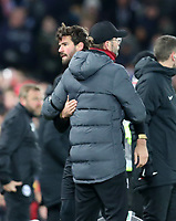 30th November 2019; Anfield, Liverpool, Merseyside, England; English Premier League Football, Liverpool versus Brighton and Hove Albion; Liverpool goalkeeper Alisson is embraced by Liverpool manager Jurgen Klopp as he leaves the field after being shown a red card  for intentional handball outside the box - Strictly Editorial Use Only. No use with unauthorized audio, video, data, fixture lists, club/league logos or 'live' services. Online in-match use limited to 120 images, no video emulation. No use in betting, games or single club/league/player publications