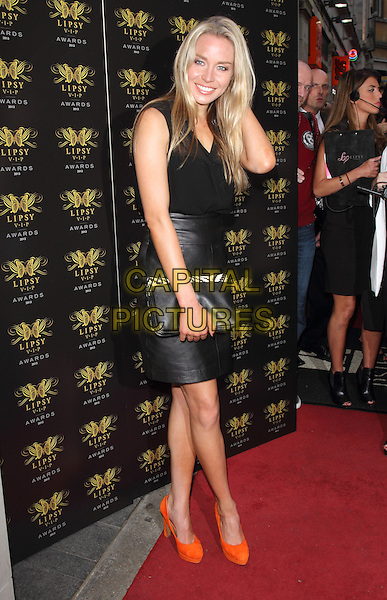 Noelle Reno<br /> Lipsy VIP Fashion Awards at DSTRKT, London, England.<br /> May 29th 2013<br /> full length black leather skirt top clutch bag orange shoes <br /> CAP/ROS<br /> &copy;Steve Ross/Capital Pictures