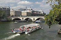 General view of Paris including the River Seine with the Pont Royal and the Mus&eacute;e d'Orsay in the background. Also a pleasure boat. Ref: 200306061982.<br />