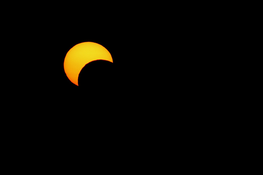 "I documented this rare solar ""annular"" eclipse on May 20th, 2012 @ 8:15pm. This partial view was visible low on the horizon here in the Hill country of Central Texas.."