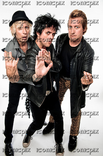 GREEN DAY- L-R: Mike Dirnt, Billie Joe Armstrong, Tre Cool -  photographed in Newport Beach, CA USA - July 10, 2012. Photo credit: Kevin Estrada / IconicPix  (RESTRICTIONS APPLY - PLEASE CALL TO CONFIRM)