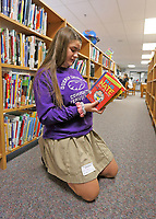 Megan Cunningham helps out in the library at Our Lady of Grace School in Noblesville.