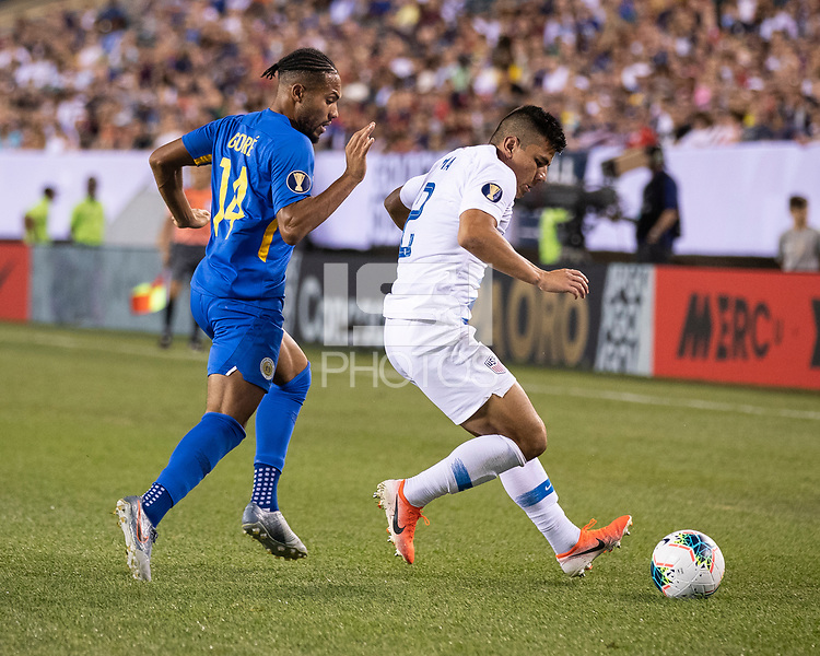 PHILADELPHIA, PA - JUNE 30: Kenji Gorre #14 and Nick Lima #2 go for the ball during a game between Curaçao and USMNT at Lincoln Financial Field on June 30, 2019 in Philadelphia, Pennsylvania.