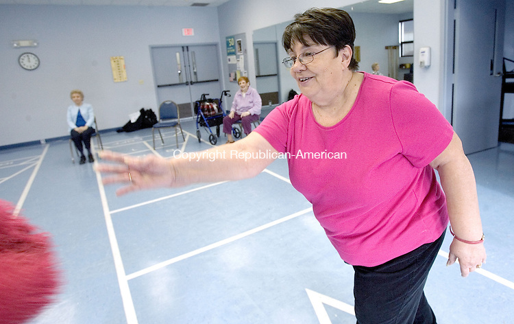 TORRINGTON, CT. 05 December 2011-120511SV08-Kathy Haluchak of Torrington instructs a Arthritis Foundation Exercise Program at the Sullivan Senior Center in Torrington Monday. Charlotte Hungerford Hospital sponsors the program for seniors.<br /> Steven Valenti Republican-American
