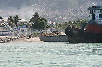 U.S. Coast Guard photo by CGC Forward. - the devastation caused by an earthquake measuring 7 plus on the Richter scale rocked Port au Prince Haiti just before 5 pm yesterday, January 12, 2009.