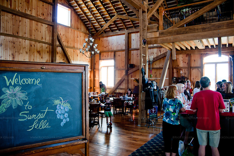 The beautifully restored barn provides a warm and comfortable environment for wine tasting, snacking, and a nice chat at Sunset Hills Vineyard and Winery, Purcellville VA.