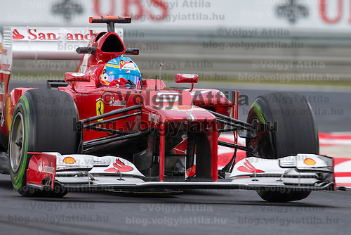 Ferrari Formula One driver Fernando Alonso of Spain drives his car during a free practice session during the Hungarian F1 Grand Prix in Mogyorod (about 20km north-east from Budapest), Hungary. Friday, 27. July 2012. ATTILA VOLGYI