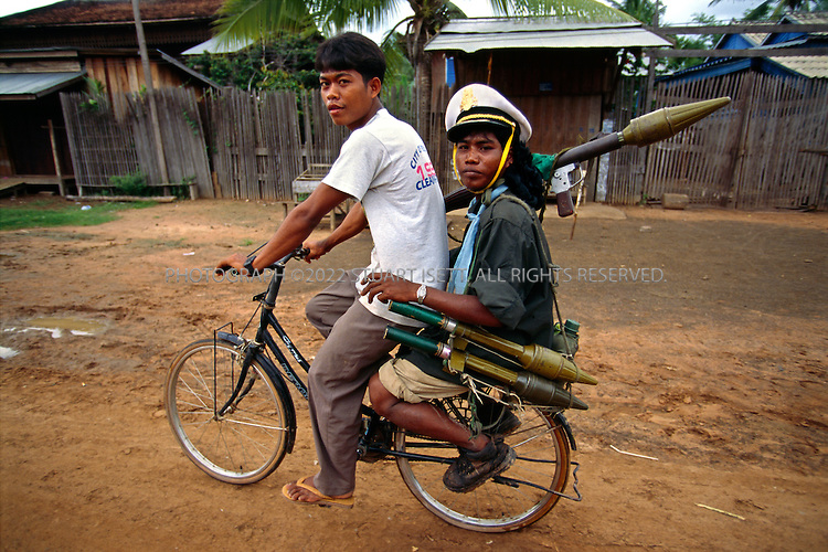 7/15/1997--Samrong, Cambodia...A government soldier, loyal to Hun Sen, goes north to fight Royalists forces after the Coup...All photographs ©2003 Stuart Isett.All rights reserved.This image may not be reproduced without expressed written permission from Stuart Isett.