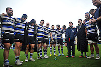 Bath players and management are all smiles in a huddle after the match. Amlin Challenge Cup quarter-final, between Bath Rugby and CA Brive on April 6, 2014 at the Recreation Ground in Bath, England. Photo by: Patrick Khachfe / Onside Images