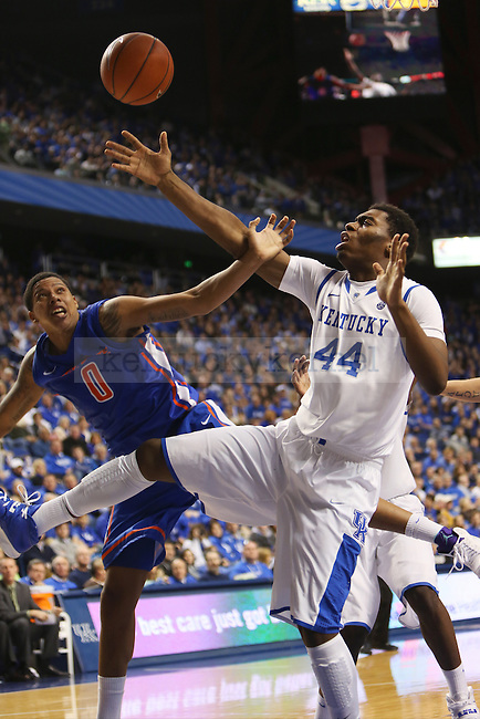 UK center Dakari Johnson attempting to save the ball from flying out of bounds against Boise State forward Ryan Watkins during the second half of the UK basketball game vs. Boise State on Tuesday, December 10, 2013, in Lexington, Ky. Photo by Kalyn Bradford | Staff