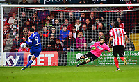 Chesterfield's Kristian Dennis scores Chesterfield's goal  from the penalty spot past Lincoln City's Josh Vickers<br /> <br /> Photographer Andrew Vaughan/CameraSport<br /> <br /> The EFL Sky Bet League Two - Lincoln City v Chesterfield - Saturday 7th October 2017 - Sincil Bank - Lincoln<br /> <br /> World Copyright &copy; 2017 CameraSport. All rights reserved. 43 Linden Ave. Countesthorpe. Leicester. England. LE8 5PG - Tel: +44 (0) 116 277 4147 - admin@camerasport.com - www.camerasport.com