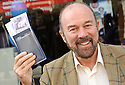 SIR BRIAN SOUTER PREPARES TO MAKE A DEPOSIT AS HE OFFICIALLY OPENS THE NEW AIRDRIE SAVINGS BANK IN FALKIRK. <br /> <br /> THE BRANCH IS THE FIRST TO BE OPENED OUTSIDE THE UK'S ONLY INDEPENDENT BANK'S TRADITIONAL LANARKSHIRE BASE.