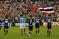 Members of DC United saluting the fans after the victory. DC United defeated the Los Angeles Galaxy 1-0 at RFK Stadium in Washington DC, Thursday August 9, 2007.