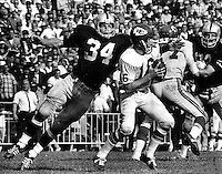 Oakland Raider linebacker Gus Otto about to sack Kansas City Chief QB Len Dawson. Copyright Ron Riesterer