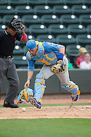 Myrtle Beach Pelicans catcher Victor Caratini (17) chases after the baseball during the game against the Winston-Salem Dash at BB&T Ballpark on May 10, 2015 in Winston-Salem, North Carolina.  The Pelicans defeated the Dash 4-3.  (Brian Westerholt/Four Seam Images)