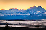 Sunrise on Mounts Hess $ Deborah, Alaska Range, view from Denali Hway. Fog blankets the valley. Southcentral Alaska, Summer.