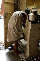 Jyoti prepares to bathe.