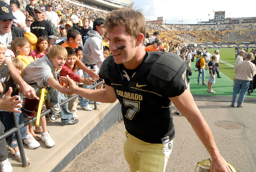 06 September 08: Colorado quarterback Cody Hawkins slaps hands with young fans after a game against Eastern Washington. The Colorado Buffaloes defeated the Eastern Washington Eagles 31-24 at Folsom Field in Boulder, Colorado. FOR EDITORIAL USE ONLY