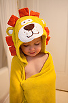 My younger son, age two, loves being wrapped in his lion towel after a bath.