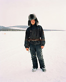 FINLAND, Artic, Nunnanen, portrait of a mid adult man standing. He is a husky driver.