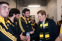 Prince Harry greets Heiden Bedwell-Curtis in the changing rooms after the Super Rugby match between the Hurricanes and Sharks at Westpac Stadium, Wellington, New Zealand on Saturday, 9 May 2015. Photo: Dave Lintott / lintottphoto.co.nz
