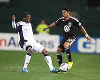 Cristian Castiilo #12 goes for the ball against Sainey Nyassi #14 of D.C. United of the New England Revolution during an MLS match on April 3 2010, at RFK Stadium in Washington D.C.
