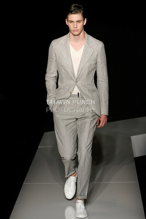 Joe walks runway in a grey and ivory gingham linen/cotton jacket, ivory fine gauge wool v-neck sweater, and grey wool linen trouser, from the Joseph Abboud Spring Summer 2013 fashion show, during New York Fashion Week Spring 2013.