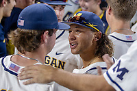 Michigan Wolverines outfielder Jordan Brewer (22) celebrates with his teammates following the game against the Vanderbilt Commodores during Game 1 of the NCAA College World Series Finals on June 24, 2019 at TD Ameritrade Park in Omaha, Nebraska. Michigan defeated Vanderbilt 7-4. (Andrew Woolley/Four Seam Images)