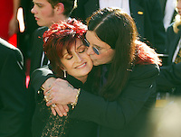 Ozzy and Sharon Osbourne share an affectionate moment at the 2002 Emmys. Sharon had just been diagnosed with cancer, which she went on to beat.