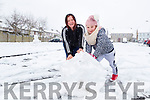 Susan and Saoirse Purcell  enjoying the snow in Listowel on Friday.