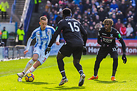 Huddersfield Town's defender Florent Hadergjonaj (33) takes on Crystal Palace's midfielder Jeffrey Schlupp (15) during the EPL - Premier League match between Huddersfield Town and Crystal Palace at the John Smith's Stadium, Huddersfield, England on 17 March 2018. Photo by Stephen Buckley / PRiME Media Images.