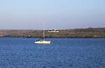 Yacht and  farmhouse on Ringarogy Island from Baltimore, Roaringwater Bay, County Cork, Ireland, Irish Republic