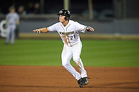 UCF Knights shortstop Brennan Bozeman (21) leads off first base during a game against the Siena Saints on February 17, 2017 at UCF Baseball Complex in Orlando, Florida.  UCF defeated Siena 17-6.  (Mike Janes/Four Seam Images)