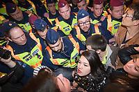 UNGARN, 09.04.2017, Budapest - V. Bezirk. Demonstration gegen den Beschluss der Fidesz-Regierung, den Weiterbetrieb der von George Soros finanzierten und fuer ihre Liberalitaet und Weltoffenheit bekannte. Zentraleuropaeishcen Universitaet CEU legislativ zu verunmoeglichen. -Die Abschlusskundgebung auf dem Kossuth-Platz geht in eine Belagerung des Parlaments ueber. Starke Polizeikraefte schuetzen das Gebaeude. Wichtigste Frontkaempferinnen sind 20-jaehrige Maedchen. | Demonstration against the Fidesz government's decision to legally make it impossible to further uphold the Central European University, financed by George Soros and known for its liberal and cosmopolitan spirit. -The final manifestation on Kossuth square turns into a siege of the parliament building. Heavy police forces are on guard. Main front line fighters are 20-year-old girls. <br /> &copy; Martin Fejer/EST&amp;OST