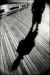 Man's shadow on boardwalk