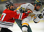 18 January 2008: University of Vermont Catamounts' forward Jonathan Higgins, a Sophomore from Stratham, NH, is checked by Northeastern University Huskies' forward Steve Silva, a Freshman from Tyngsboro, MA, during action at Gutterson Fieldhouse in Burlington, Vermont. The two teams battled to a 2-2 tie in the first game of their 2-game weekend series...Mandatory Photo Credit: Ed Wolfstein Photo