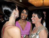 Washington, D.C. - May 9, 2009 -- White House Social Secretary Desirée Rogers, center, and Senior White House Advisor Valerie Jarrett, right, share conversation with an unidentified woman at left as they attend one of the parties prior to the White House Correspondents Dinner in Washington, D.C. on Saturday, May 9, 2009..Credit: Ron Sachs / CNP.(RESTRICTION: NO New York or New Jersey Newspapers or newspapers within a 75 mile radius of New York City)