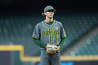 Baylor Bears relief pitcher Jimmy Winston (24) looks to his catcher for the sign against the Arkansas Razorbacks in game nine of the 2020 Shriners Hospitals for Children College Classic at Minute Maid Park on March 1, 2020 in Houston, Texas. The Bears defeated the Razorbacks 3-2. (Brian Westerholt/Four Seam Images)